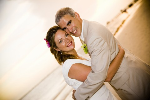 Blog author at her wedding on the beach with husband.