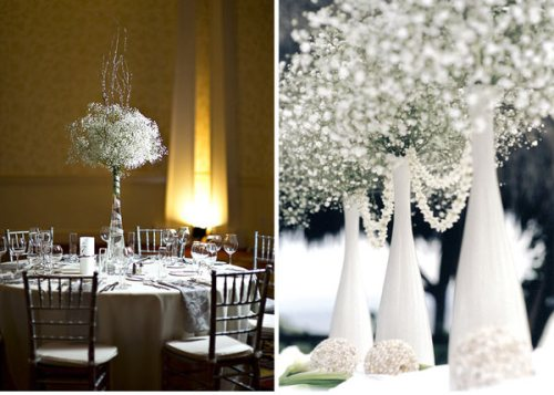 very tall white vase with baby's breath shaped in a topiary ball