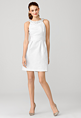 white knee length shift with white beads around neckline