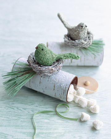 hide candy inside a log looking favor box with green bird on top